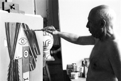 Figure 2. Pablo Picasso adding paint to an artwork.